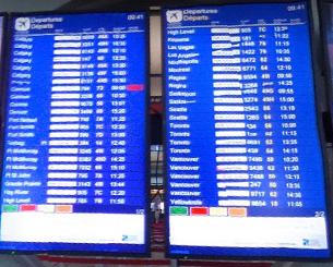 edmonton-airport-departures-YEG-boards-in-terminal